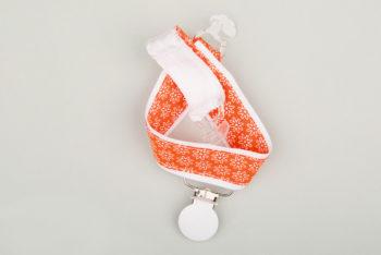 Jart'elle fleurettes sur orange liseré et pince blancs