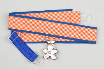 jart'elle vichy orange et blanc sur fond bleu et pince fleur qui empêche les jupes de s'envoler à vélo - Les filles à vélo