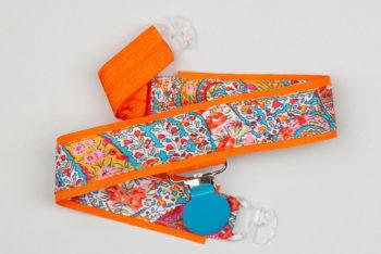 Jart'elle Liberty Bourton fond orange pince ronde bleue qui empêche les jupes de s'envoler à vélo - Les filles à vélo