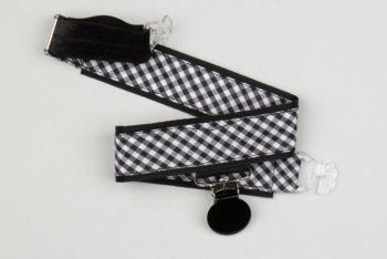 Jart'elle vichy noir et blanc sur fond noir pince ronde noire qui empêche les jupes de s'envoler à vélo - Les filles à vélo