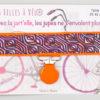 Jart'elle Liberty Torsten violet fond et pince orange qui empêche les jupes de s'envoler à vélo - Les filles à vélo